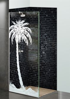 Shower Divider Panel featuring the Date Palm Single design in the 1D Positive Clear effect by Sans Soucie Art Glass. Design elements are sandblast etched on the top surface of smooth, clear glass, and are solid white shapes.  This effect is considered semi-private, as the clear glass background area of the glass, will vary by design.