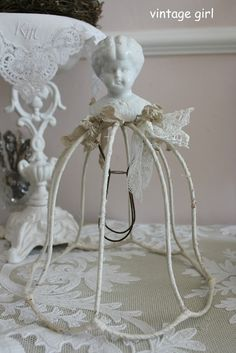 sweet....create with an old lampshade, lace and doll head..