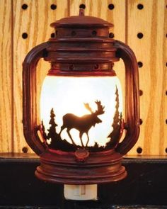 Outlet Night Light Lantern with Moose Scene, 6-inch by Night Light. $12.95. Great night light that looks like a mini lantern. Plugs into standard outlet. Measures 6 inches tall. Uses a standard night light C7 bulb. Has an on/off switch on bottom of lamp. Includes a nice raised moose scene on the globe.