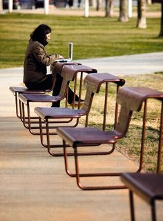 Urban benches with multiple functions - El Poeta by BD Barcelona. Seat facing one way, turn around and it becomes a desk or table.