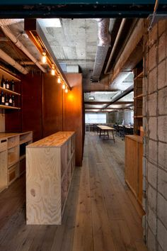 Suppose Tokyo Office is a minimalist interior located in Tokyo, Japan, designed by Suppose Design Office. The space is comprised of industrialized materials such as old scaffold board for the flooring, and an exposed concrete wall. (9)