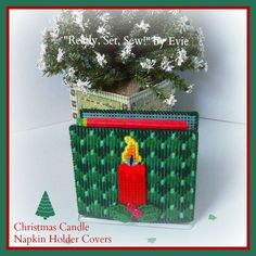 """☆ """"Merry and bright"""" should extend to your napkin holder covers. Christmas Candle, Christmas 2016, Christmas Themes, Christmas Ornaments, Plastic Canvas Christmas, Plastic Canvas Crafts, Plastic Canvas Patterns, Cross Stitch Designs, Cross Stitch Patterns"""