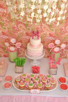 What could be sweeter than this pretty paisley party for a baby girl? Adorned with green and pink monogrammed details, this baby cake table is truly wow-worthy. Check out this baby birthday inspiration and start planning your little girl's very own Pretty and Paisley-themed first birthday bash!