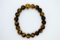 A natural luck and money bringer, tiger's eye keeps potential shopaholics in check as it injects a reality principle into finances. Tiger's Eye traditionally protects against the evil eye. Wear Tiger's Eye Bracelet for protection and to attract wealth. Gemstone Bracelets, Gemstone Jewelry, Golden Tiger, Tiger Eye Bracelet, Tiger Eye Beads, Handmade Sterling Silver, Evil Eye, Beaded Necklace, Gemstones