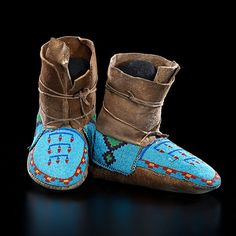 Assiniboine Beaded Hightop Moccasins  thread-sewn smoke-tanned elk or moose hide; beaded using light blue, greasy yellow, pea green, red white-heart, and dark blue, length 10 in.  ca 1900 http://www.liveauctioneers.com/item/12981687_assiniboine-beaded-hightop-moccasins