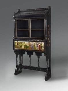 Black oak cabinet, decorated with an oil painted panel by William De Morgan depicting St George and the dragon from the Current Exhibition | The De Morgan Foundation