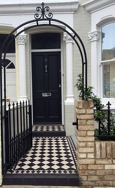 london victorian front garden company black and white chequer board mosaic yellow brick wall metal rail and gate rose arch