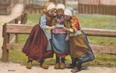 Marken-Holland-little-Dutch-Girls-read-a-letter-wooden-shoes-c1910-Postcard