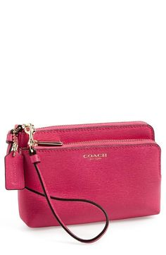 This pink Coach leather wristlet is perfect for the weekend.