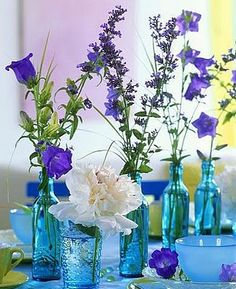 Love The Blue Bottles And Purple Flowers With One White Peonie Jamie Diaz Turquoise Bathroom
