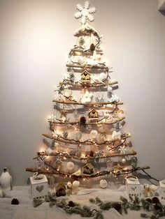 Learn how to make Easy DIY Christmas Decorations on a Budget Simple - Christmas Tree Made from Twigs! You can buy all the supplies you need at your local dollar store and even use twigs from your yard for this awesome holiday decor idea! Wall Christmas Tree, Xmas Tree, Simple Christmas, Driftwood Christmas Tree, Minimal Christmas, Christmas Photos, Christmas Christmas, Christmas Themes, Christmas Wreaths