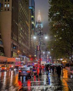 Walking on 42nd Street in the rain - New York City.