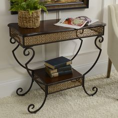 Decorate your entryway in style with our Mahogany Two-Tier Console Table. With gold accents and two display surfaces, it's the perfect addition to any hallway or foyer!