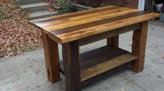 """Big and Chunky kitchen island with 2"""" thick top of mixed hardwoods from barn over 100 years old. The legs are hand hewn / ax cut posts with really cool ax markings..."""