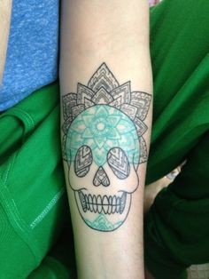 A new take on the sugar skull, the mandala skull tattoo is a religious or spiritual symbol that represents unity, eternity and completeness. This arm tattoo features a mandala skull tattoo inked in black and white with a pretty green color inked across the forehead and chin. The skull tat ...
