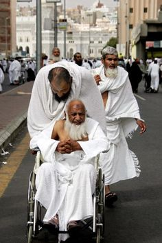 How are Muslims with disabilities treated in the Islamic community?: A disabled Muslim man in a wheelchair during the annual Hajj.