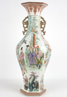 Description A large Chinese famille rose porcelain baluster vase the flared mouth over tapering body flanked with twin stylised bird shaped pierced handles. The neck decorated with palmettes in coral enamels. the body painted with a scene of a horsemam confronting others in a landscape setting. the lower section decorated with rocks and trees. The base with qianlong mark in sealscript  Date The base with qianlong mark but not of the period  www.collectorstrade.de  SOLD !!!