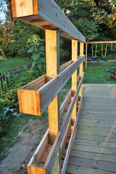 Garden fence built with mini planter boxes to fill with herbs and beneficials!