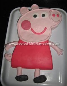 Peppa Pig Cake: This Peppa Pig cake was made for my darling daughter's 3rd birthday.  I made a regular chocolate sponge mix (6 eggs) baked in two 10 x 7 cake tins and
