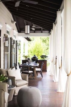 Outdoor drapery helps blur the lines between indoor spaces and exterior porches filled with upholstery, swings and places for dining and entertaining. Outdoor Retreat, Outdoor Rooms, Outdoor Dining, Dining Area, Dining Room, Outdoor Curtains, Patio Dining, Outdoor Areas, Outdoor Fabric