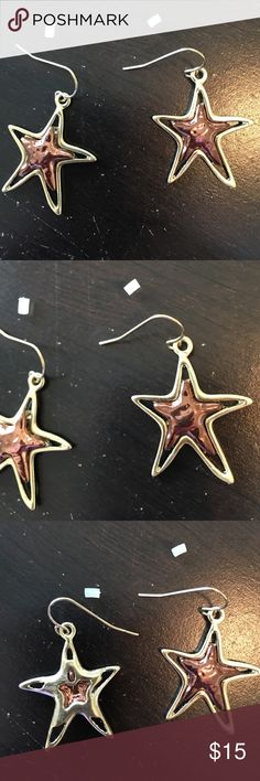 "Pierced Earrings copper / gold tone dangle Stars. Pierced Earrings copper / gold tone dangle Stars. Never been worn. Approximately 1 1/2"" long x 1"" wide. Copper inside the star and trimmed in gold tone. Jewelry Earrings"