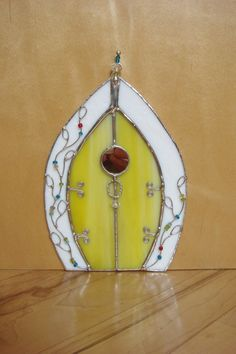 Fairy Door yellow stained glass with wire vine 25.00