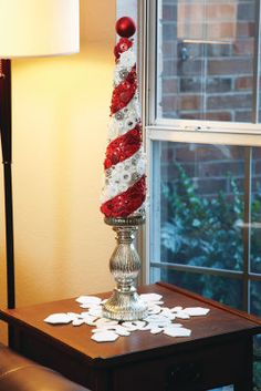 Decorated styrofoam cones decorated in all sorts of materials seem to be all the rage this year This is a great project for those who like to DIY. Choosing materials like felt, you can cut dime size felt pieces to make a rosette tree or upholstery fabric.