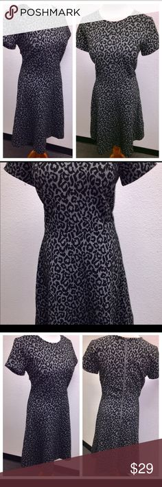 Ann Taylor Black Gray Animal Print Skater Dress 8 This auction is for a new without tags Ann Taylor black and gray animal print skater dress in a size 8. The measurements are as follows  Bust – 38 inches Waist line – 34 inches Length – 39 inches  The dress is made of 67 percent polyester, 32 percent rayon and one percent spandex. It has a zipper in the back. This dress still has the security tag sewn on the seam at the bottom it has not been worn. 122617-4 drnerds Ann Taylor Dresses