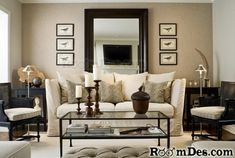 Mirror behind sofa and candles on coffee table add sophistication and warmth to a room.