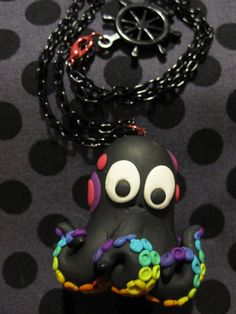 Black #clay charm with a #rainbow on his tentacles.