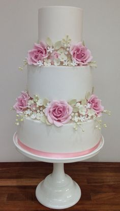 Classic vintage pink rose and hydrangea wedding cake