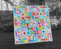 """Use 25 fat quarters or your favorite fabric scraps to make this modern medallion quilt featuring patchwork birds and butterflies!The pdf pattern includes full-size template patterns and step-by-step instructions for making an 80"""" x 80"""" medallion quilt.Aviatrix Medallion is written for maximum flexibility in fabric selection. It describes how to use exactly the same fabrics as me, how to use 25 fat quarters of your own choosing, and how to use scraps and/or differen..."""