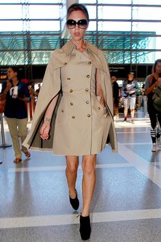 """2012Strut into the airport all like, """"Nah, I don't need layers: My trench-cape-dress hybrid has all my bases covered.""""Beckham is wearing a Junya Watanabe Comme des Garçons dress, Giuseppe Zanotti shoes, and Victoria Beckham sunglasses. For a similar style, try: #refinery29 http://www.refinery29.com/2015/06/89483/victoria-beckham-travel-outfit-inspiration#slide-6"""