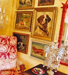 Collection of 19th c American, English & French dog portraits in living room of Lynn Von Kersting
