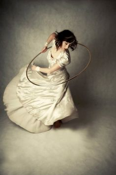 """""""A stunning shot of Josie Jupiter of Puzzle Dust Circus. She lives in lives in Melbourne, Victoria, Australia. Photo by Shami Kiely. A Hooping.org Photo of the Day."""""""