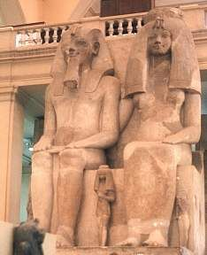 Colossal Statue of Amenhotep III at second Pylon, Queen next to left leg: Great Royal wife Tiye.