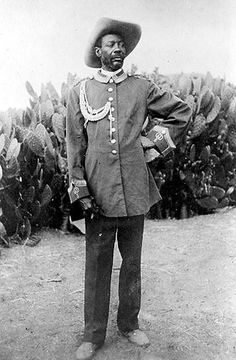 Samuel Maherero was the Herero leader who rebelled against the Germans and their seizure of Hereroland. After a brief successful insurrection, the Germans retaliated and massacred the Herero at the battle of Waterberg in 1904, the survivors fleeing into the Kalahari Desert, where most died of thirst and hunger. Samuel Maherero, however, survived and lived until 1923, but in exile in South Africa and Botswana.
