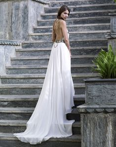"""My Favourite Dress ever :) From Amanda Wakeley  """"The bride wears a silk georgette halterneck wedding dress with Cleopatra beading detail."""""""