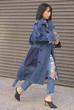 Denim trench coat paired with distressed jeans and mules.