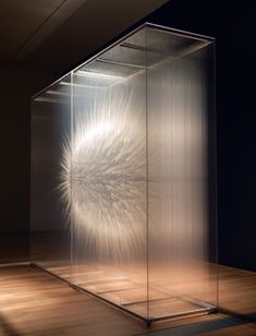 David Spriggs' paintings are inspiring. Spriggs paints celestial and explosive images on multiple panes of glass to create beautiful and luminescent 3-D pieces. The work is amazing, and huge!