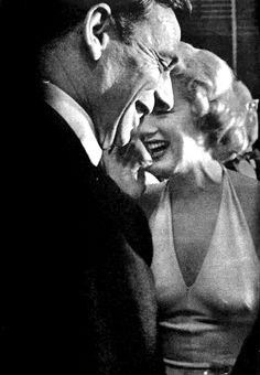 """Marilyn Monroe and Yves Montand at a press conference for Let's Make Love, 1960. """