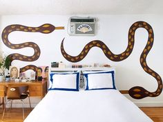"""""""It's impossible to actually hide,"""" Angelica says of the A.C. built into the wall above her bed. """"But by adding the two snakes flanking it, it became less obvious. And then I put the fan over the A.C., an extension of"""