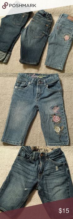 Kids Size 6 Bermuda Shorts (Levi's, Gap, Old Navy) 1st pictured is Levi's jeans with pink floral embroidery. Easy snap button and zipper for kids. Adjustable waist for kids to grow into. 2nd is Gap denim Bermuda shorts. Comfy and distressed style. Has adjustable and elastic waist. Perfect for kids. 3rd is Old Navy jeans with easy snap button for kids and adjustable waist as well. All in good condition and has several more years for another little girl to wear. Various Bottoms Shorts