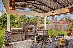 Steele Grills in an Amazing Outdoor Kitchen with a Solar Powered Arbor