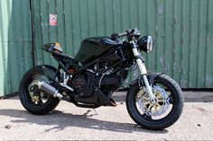 "A M900 Ducati Monster with a Ducati ST2 gas tank from ""MIM"" Made in Metal LTD of the UK"