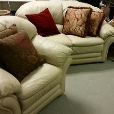 Cream leather loveseat and 2 matching chairs -