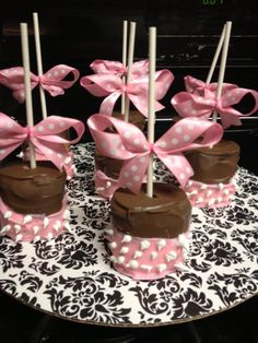 Minnie mouse marshmallows. I purchased campfire marshmallows, white chocolate with two drops of pink food coloring, and chocolate. The polka dots are made of frosting. I made the bows and hot glued them to the sticks. They were such a hit at my daughters 1st birthday party!