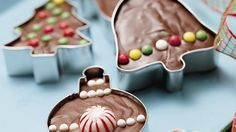 Here's a sweet gift for someone with everything.  Place cookie cutters and fudge into cellophane gift bags, and tie with ribbons.