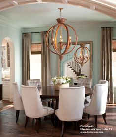 Orb chandelier lighting over a round table creates an intimate setting.
