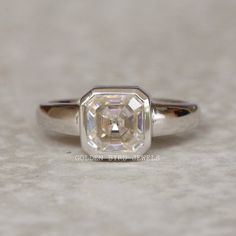 1.50 CT Asscher Moissanite Ring / 1.50 CT Near Colorless Solitaire Wedding Ring / Bezel Set Ring Promise Rings For Women / Anniversary Gifts  #Moissanite #AsscherCutMoissanite #GBJ #AsscherCutMoissanite #WeddingRing #MoissaniteRing #DiamondGoldRing #SilverRing #ProposalRing #WeddingRing #EngagementRing #DiamondWeddingRing #DiamondEngagementRing #ColorlessAsscherCutMoissaniteWhiteGoldPromiseRing #AsscherCutMoissanite #SilverDiamondRing #SterlingSilverRing #MoissaniteWeddingRing Moissanite Wedding Rings, Wedding Rings Solitaire, Diamond Solitaire Rings, Diamond Engagement Rings, Bezel Set Ring, Proposal Ring, Solid Gold Jewelry, Rings For Her, Types Of Rings